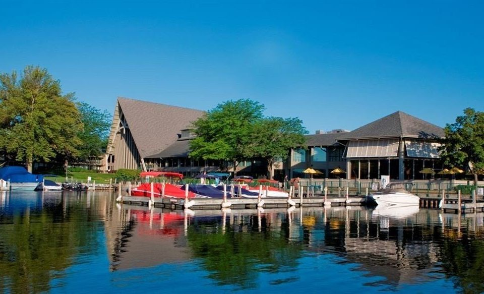 water sky house scene Harbor Boat leisure marina Resort swimming pool dock waterway boathouse docked lined Town surrounded colored