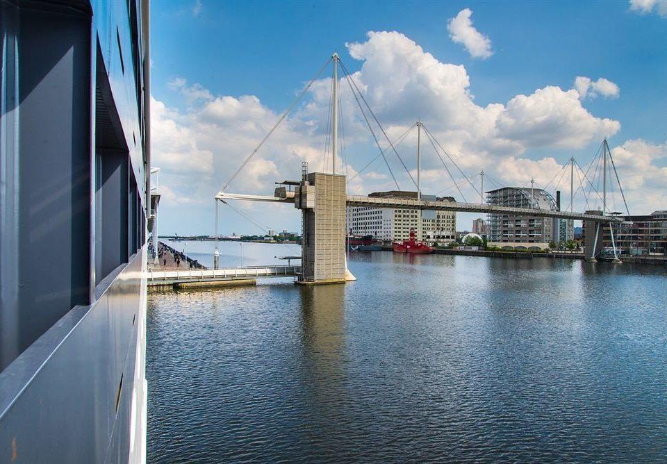 sky water Boat scene dock bridge marina vehicle waterway Sea cityscape Harbor day