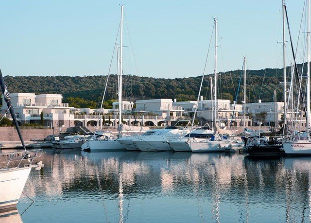 sky Boat water marina dock Harbor scene docked vehicle sailboat pier yacht mast catamaran watercraft port Sea tied day