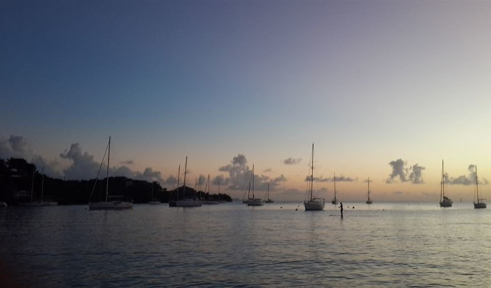 sky water atmospheric phenomenon horizon Sea dawn morning sunrise dusk Sunset watercraft evening vehicle cloud marina dock sailing vessel Boat waterway Harbor day distance