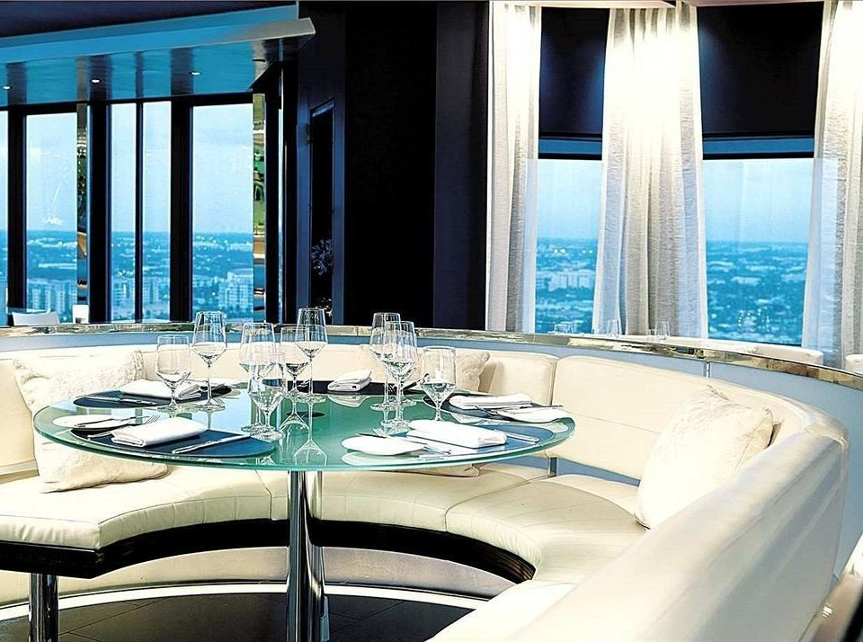 Boat passenger ship yacht luxury yacht vehicle luxury vehicle restaurant swimming pool ship watercraft overlooking dining table Island