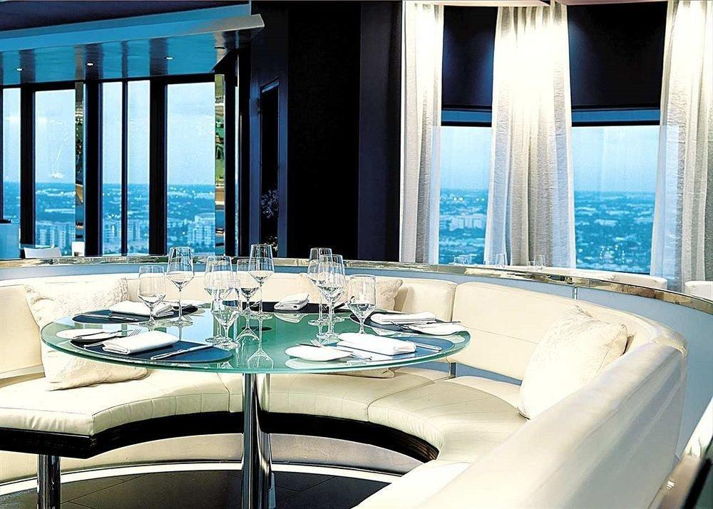 Boat passenger ship yacht luxury yacht vehicle luxury vehicle restaurant swimming pool ship watercraft overlooking dining table Island