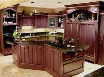 cabinet Kitchen property cabinetry countertop home hardwood cuisine classique yacht Boat vehicle cottage mansion appliance Island entertainment center