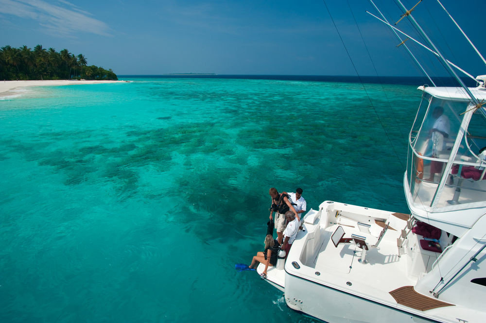 water sky Boat Sea sailing Nature caribbean Ocean Lagoon vehicle blue Parasailing sports cape Island windsports swimming