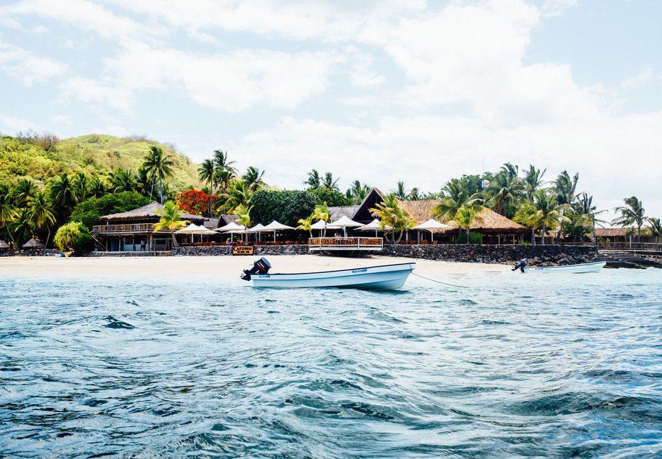 water sky Boat Sea vehicle boating Lake Island day surrounded