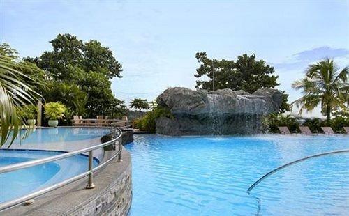 water tree Boat swimming pool property Resort resort town Lagoon Lake Villa surrounded