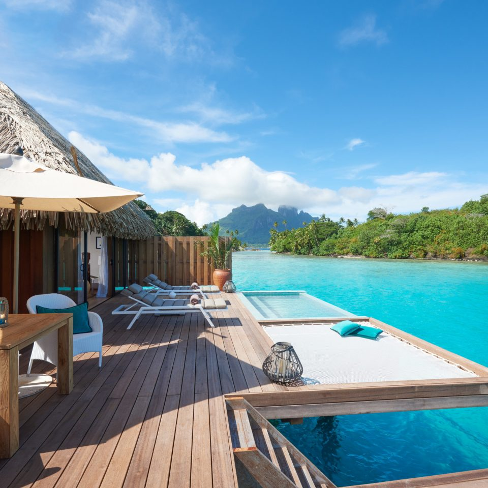 sky water Resort property swimming pool Sea leisure Villa resort town caribbean tropics Ocean cottage Lagoon Boat