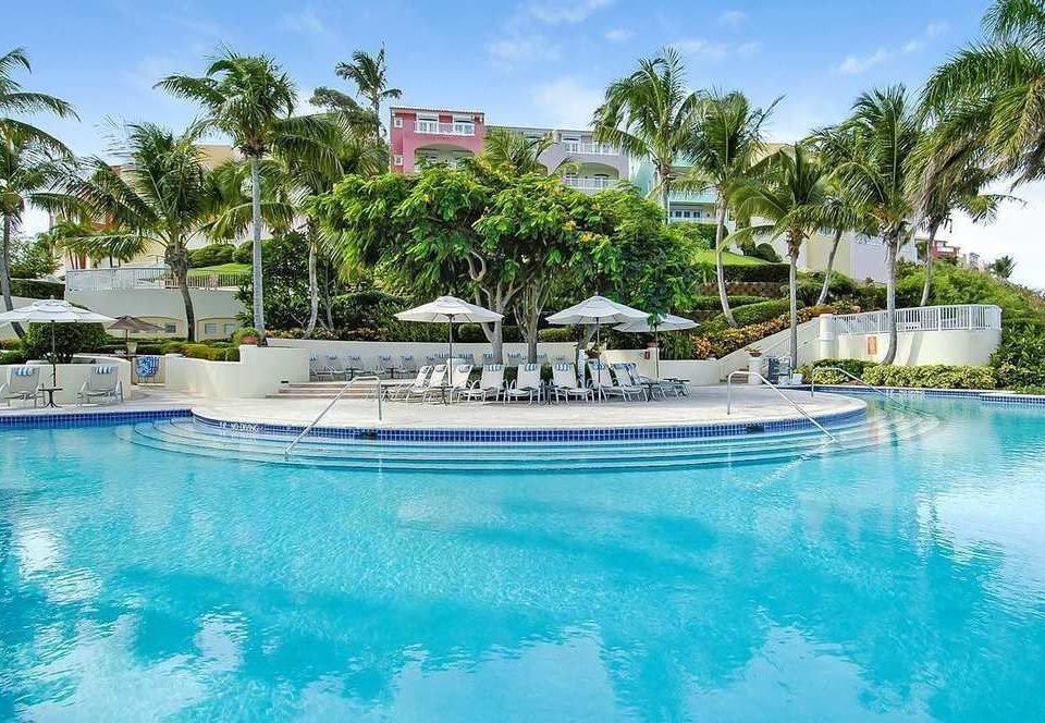 water tree Pool sky Boat Resort swimming pool swimming property leisure condominium resort town Villa blue Lagoon caribbean docked