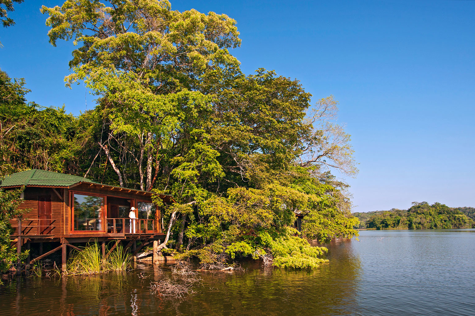 Luxury Outdoor Activities Overwater Bungalow Treehouse Waterfront tree water sky Boat River Nature Lake house plant season leaf woody plant autumn waterway pond rural area flower traveling surrounded