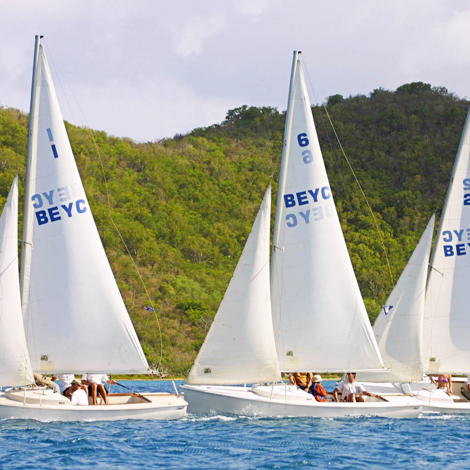 Boat Nature Ocean Outdoor Activities Outdoors watercraft tree transport sky water sailboat dinghy sailing sail sailing vehicle Lake sailing vessel mountain sailing ship scow sports sailboat racing keelboat windsports ship white dinghy yacht racing mast skiff hillside surrounded