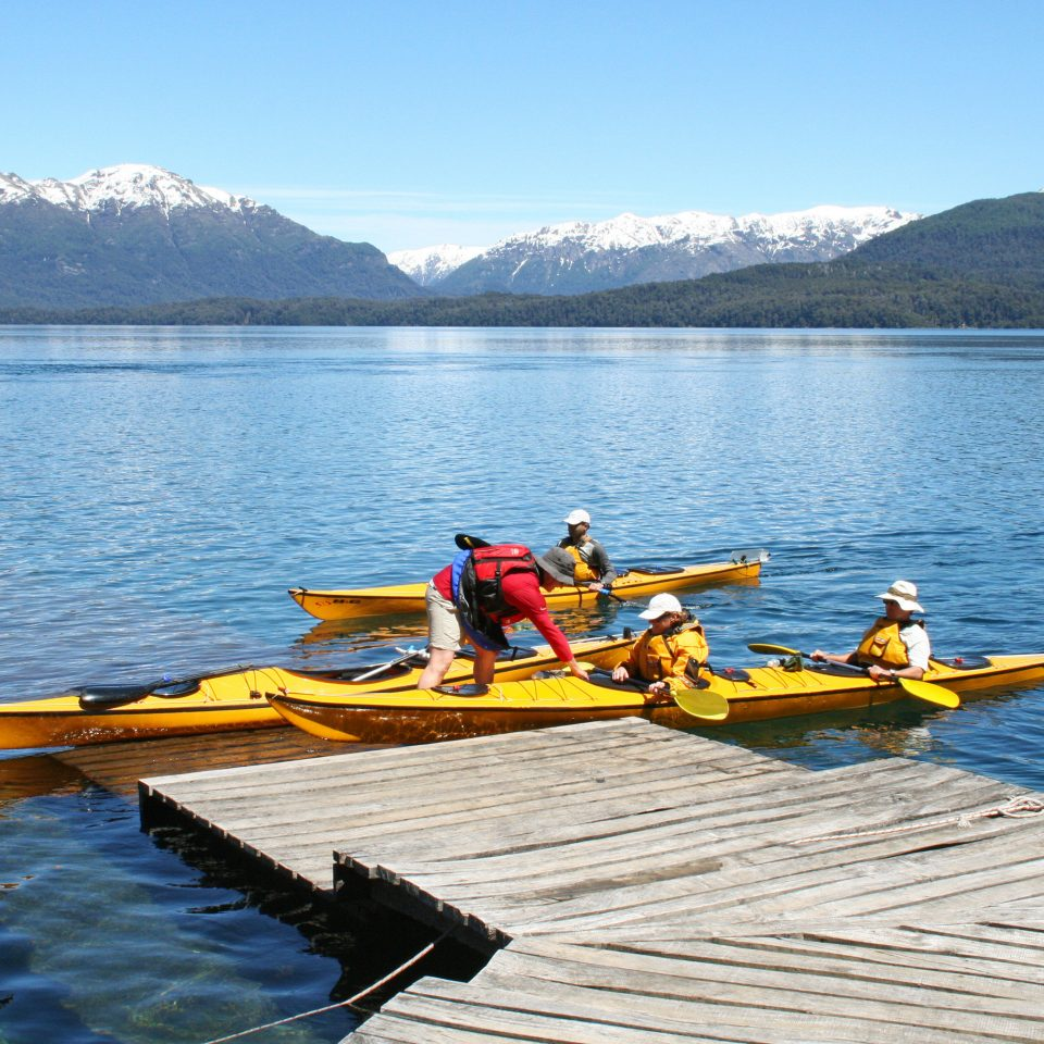 Lake Scenic views Sport Waterfront water Boat sky mountain boating vehicle sea kayak watercraft rowing canoeing Rowing kayaking kayak canoe watercraft dock Raft paddle sports equipment water sport row