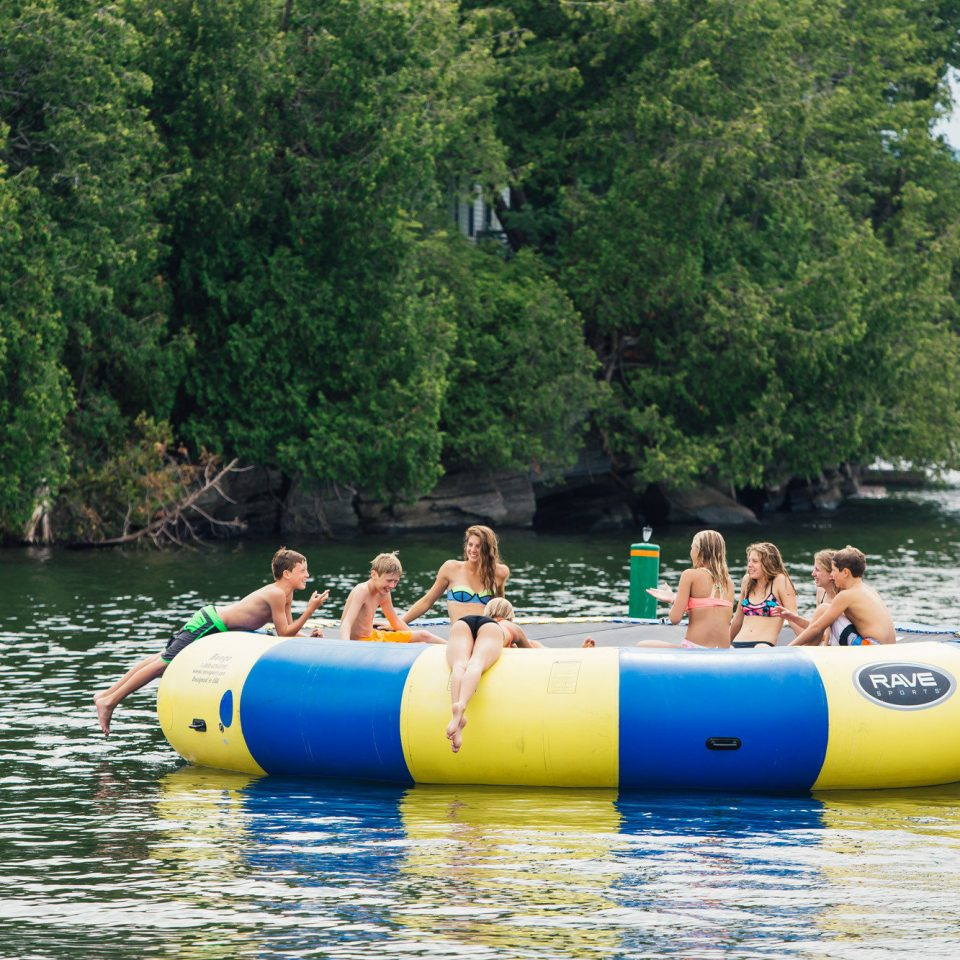 tree water leisure tubing watercraft outdoor recreation transport Raft vehicle Boat watercraft rowing boating recreation Lake park Water park paddle