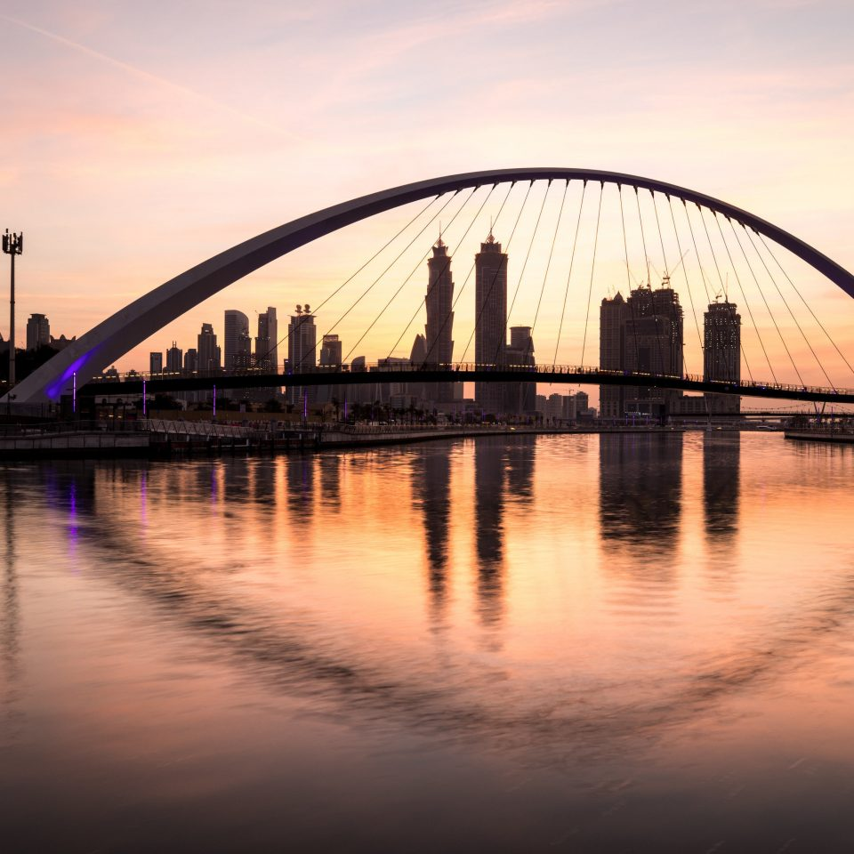 water sky bridge River Boat Lake building landmark Sunset horizon dusk dawn evening morning sunrise skyline cityscape long sunlight nonbuilding structure cable stayed bridge waterway traveling arch distance