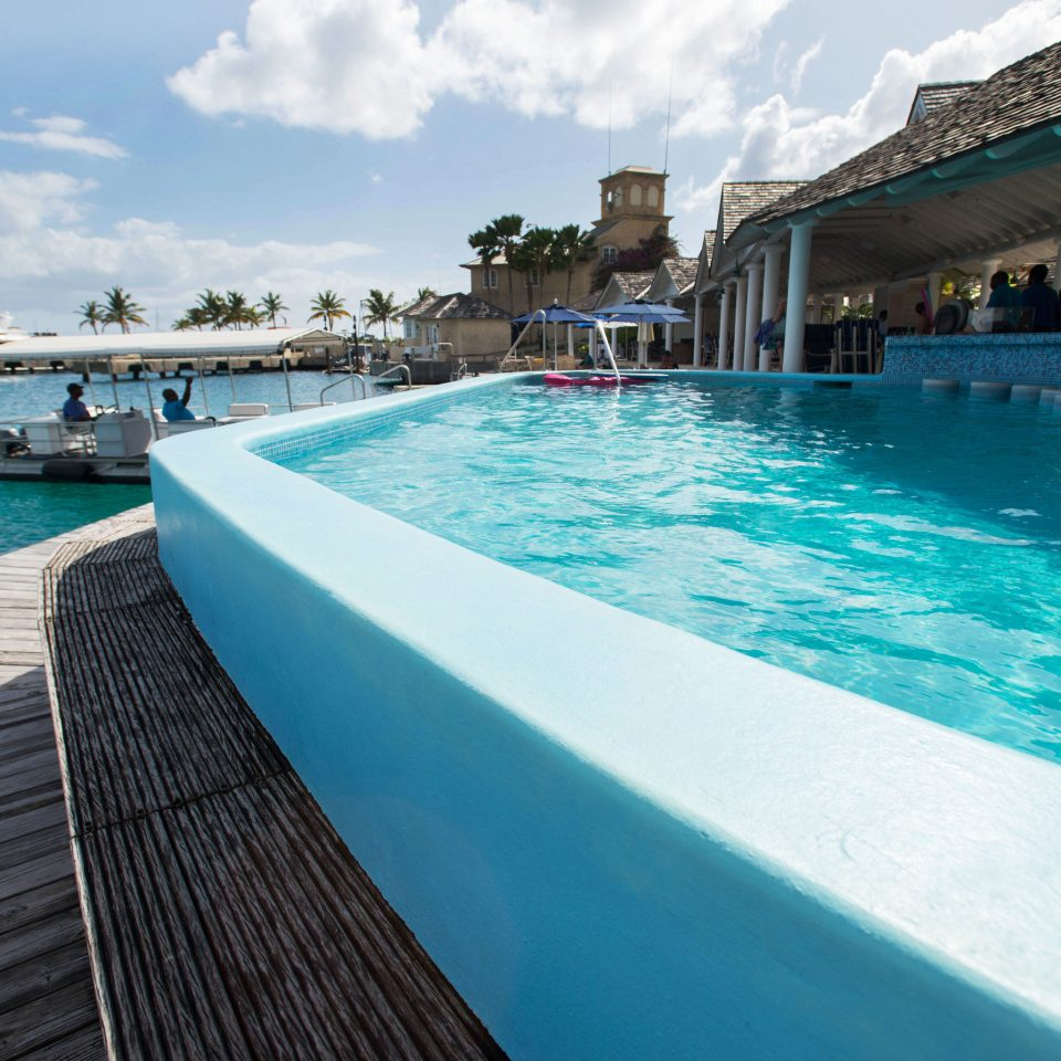 water sky Boat Pool swimming pool leisure Sea dock pier Ocean Resort swimming vehicle caribbean blue