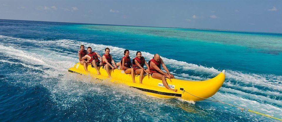 water sky ship riding yellow wave vehicle Boat boating watercraft Sea Ocean sea kayak sailing sports