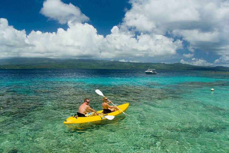sky water Boat kayak vehicle kayaking sea kayak boating yellow Sea watercraft Ocean sports equipment paddle day
