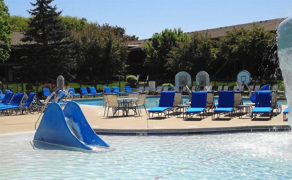 Pool Resort tree sky Boat vehicle Water park swimming pool amusement park boating park dock marina blue