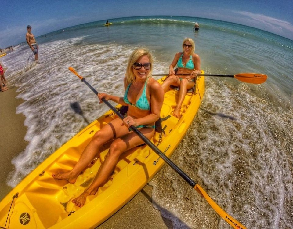 water Boat vehicle sea kayak boating kayak watercraft watercraft rowing orange yellow sports equipment kayaking paddle water sport Raft