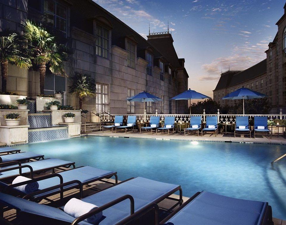 building leisure swimming pool Resort condominium plaza lined Boat