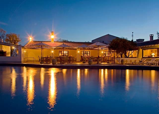water sky scene Boat night evening Resort swimming pool dusk marina palace cityscape
