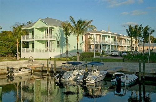 water sky Boat marina property Resort leisure dock house condominium waterway docked lined