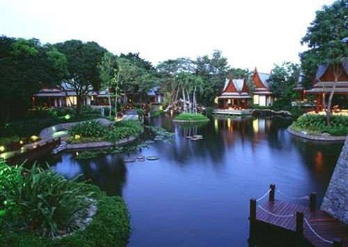 water sky tree Boat property Resort swimming pool house River waterway surrounded lined