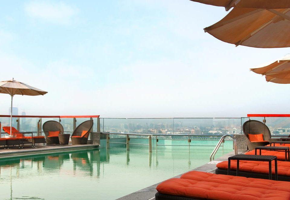 sky water Boat umbrella leisure Resort swimming pool orange Sea caribbean vehicle
