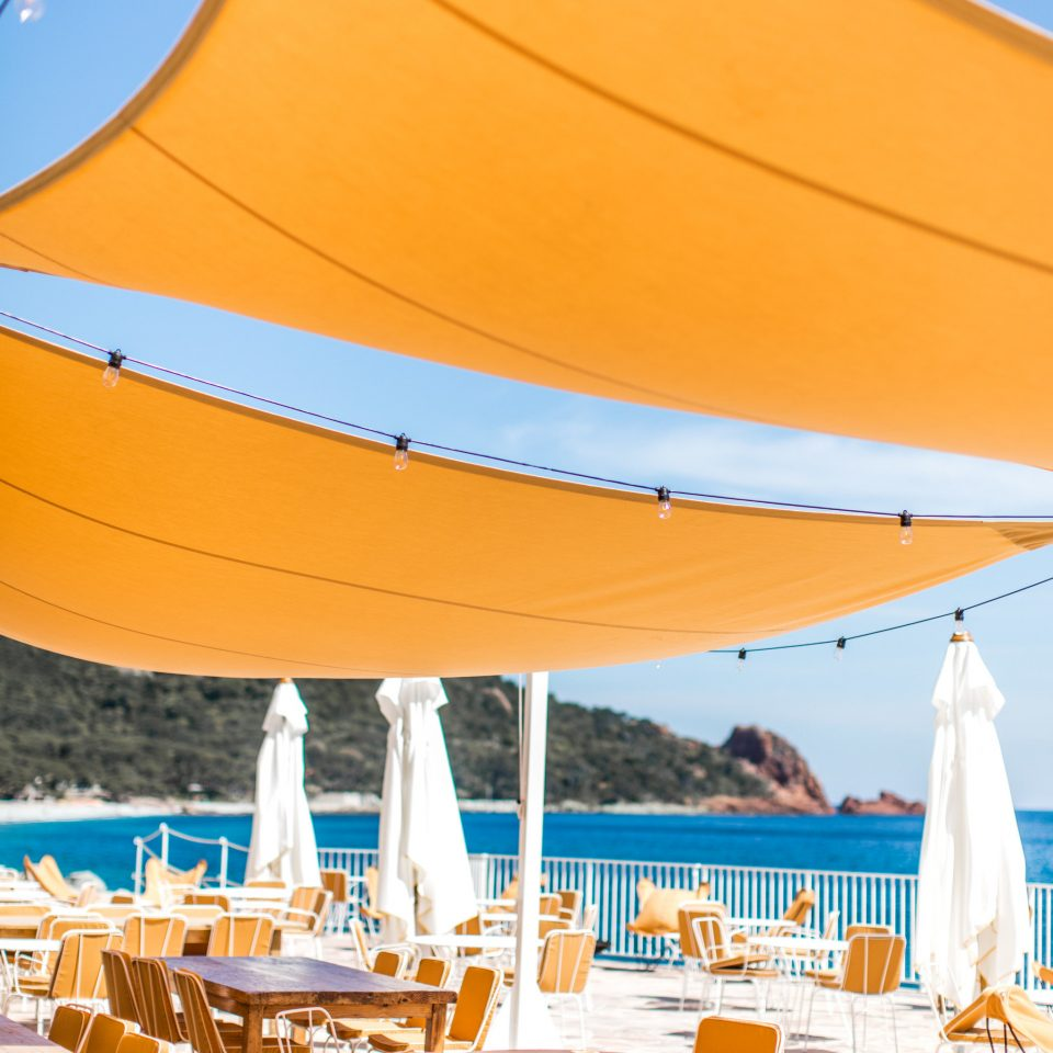 sky yellow chair umbrella orange Boat tent leisure shade canopy Sea outdoor object