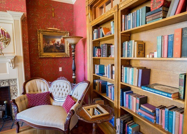 shelf book property building library home living room