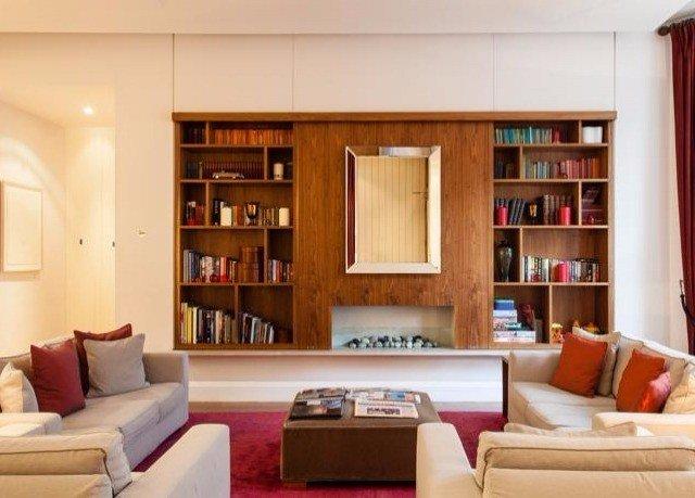 shelf sofa book living room property library home seat