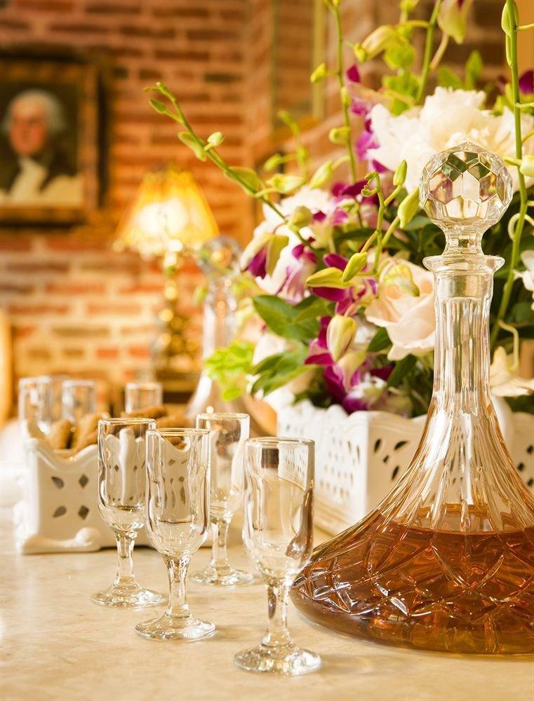 wine centrepiece flower arranging wedding flower floristry ceremony wine glass lighting stemware floral design wedding reception rehearsal dinner restaurant drinkware bottle dining table