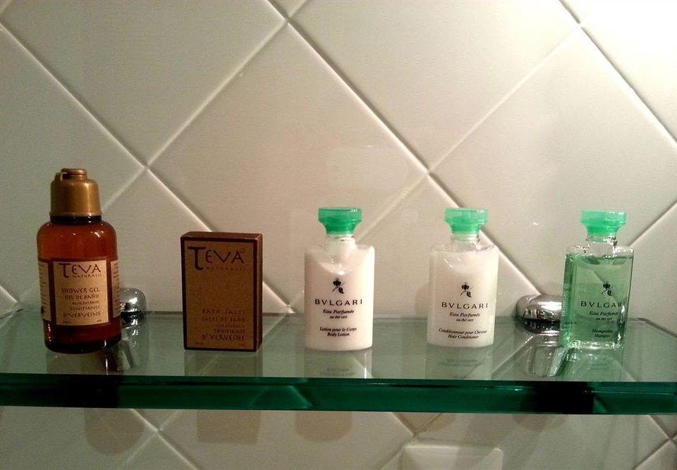 counter product bottle lighting green glass bottle drinkware glass