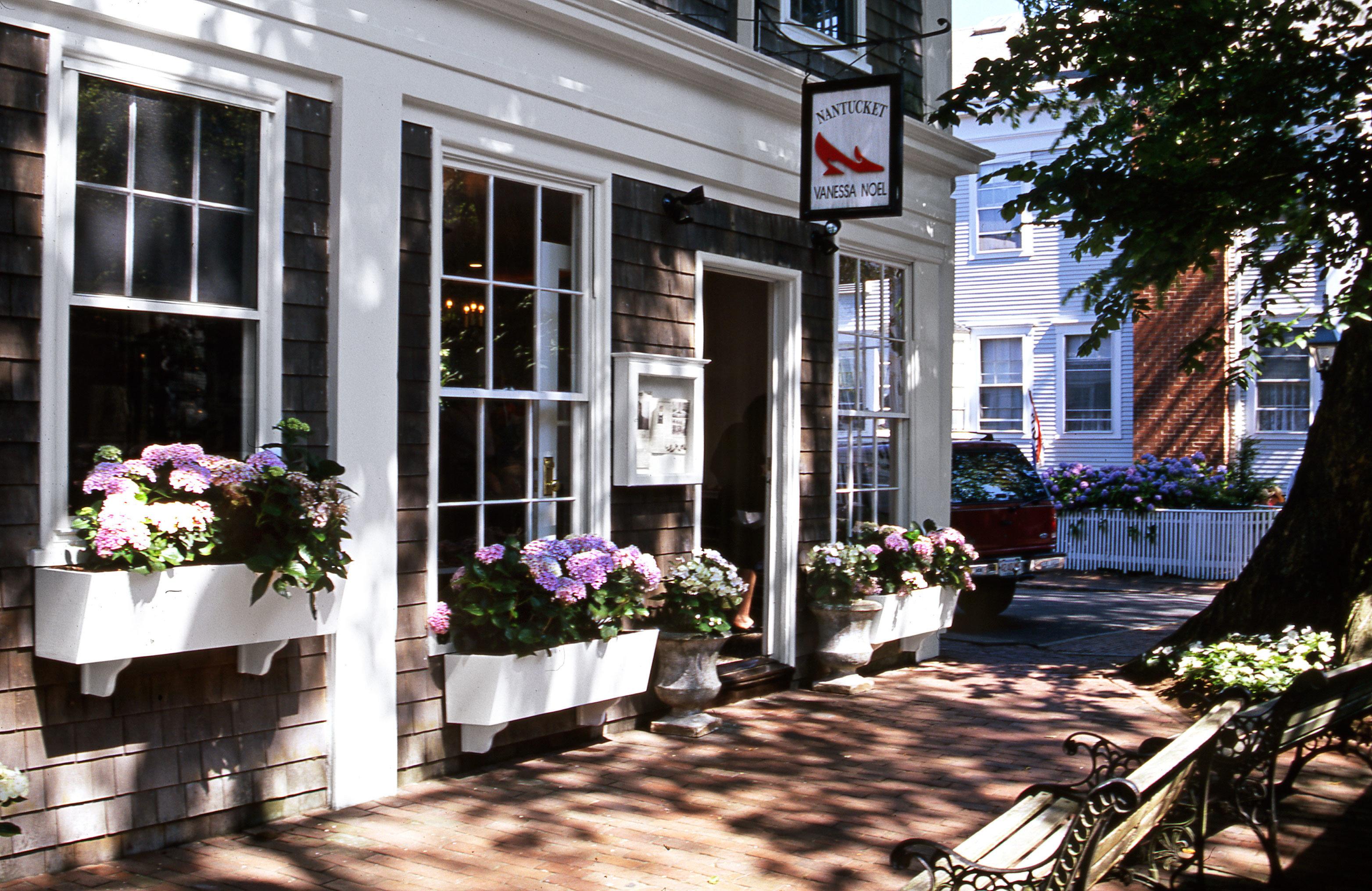 Boutique Budget Exterior Historic building home Courtyard porch backyard outdoor structure flower