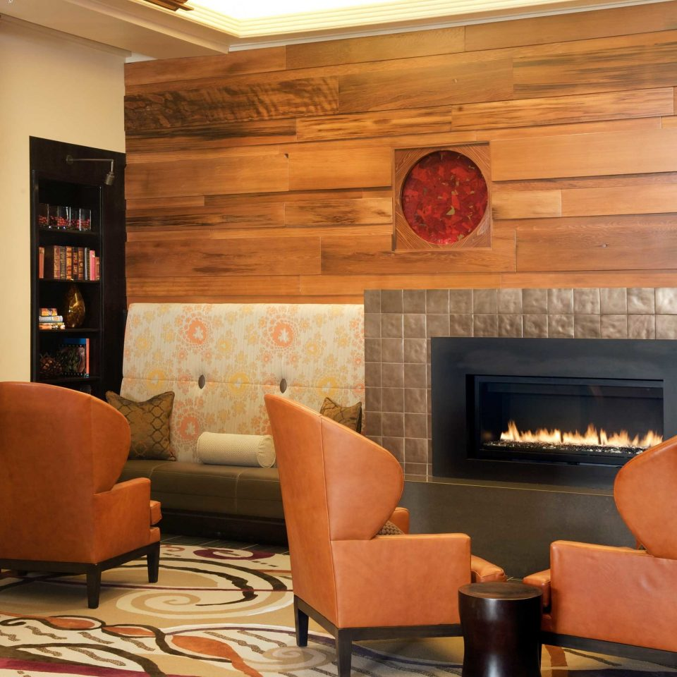 Boutique City Fireplace Lobby Lounge chair living room property hearth home Dining hardwood sofa leather