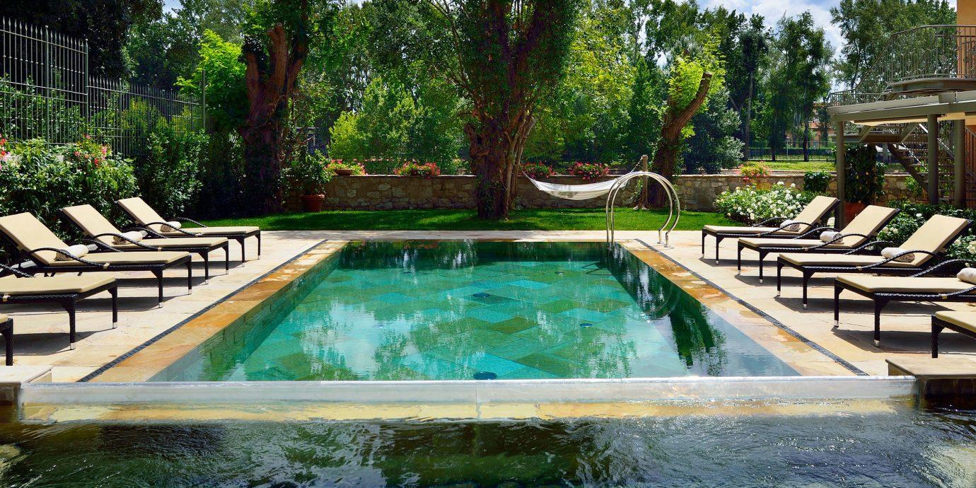 Boutique City Elegant Grounds Historic Honeymoon Pool Romance Romantic tree swimming pool property leisure backyard reflecting pool Resort Villa mansion