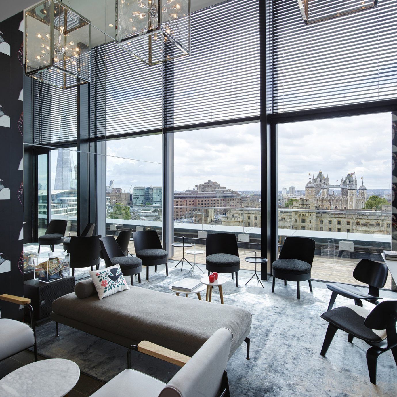 artistic artsy books Boutique charming City city views contemporary cozy decor Elegant fancy Hip homey interior library living area living room Lounge Luxury Modern natural light sophisticated Style + Design stylish trendy view windows property condominium restaurant