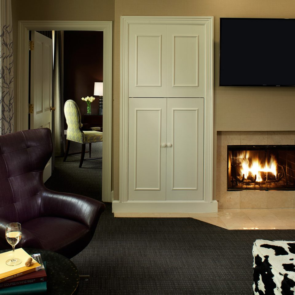 Boutique City Fireplace Modern Suite living room property home house hardwood hearth flooring cottage wood flooring