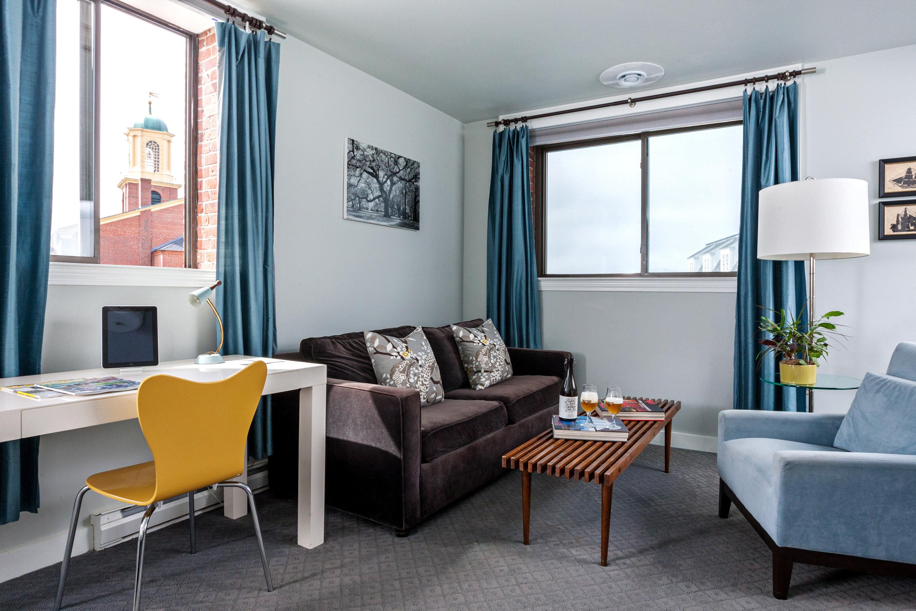 Boutique City Hip Inn living room chair property condominium home Suite