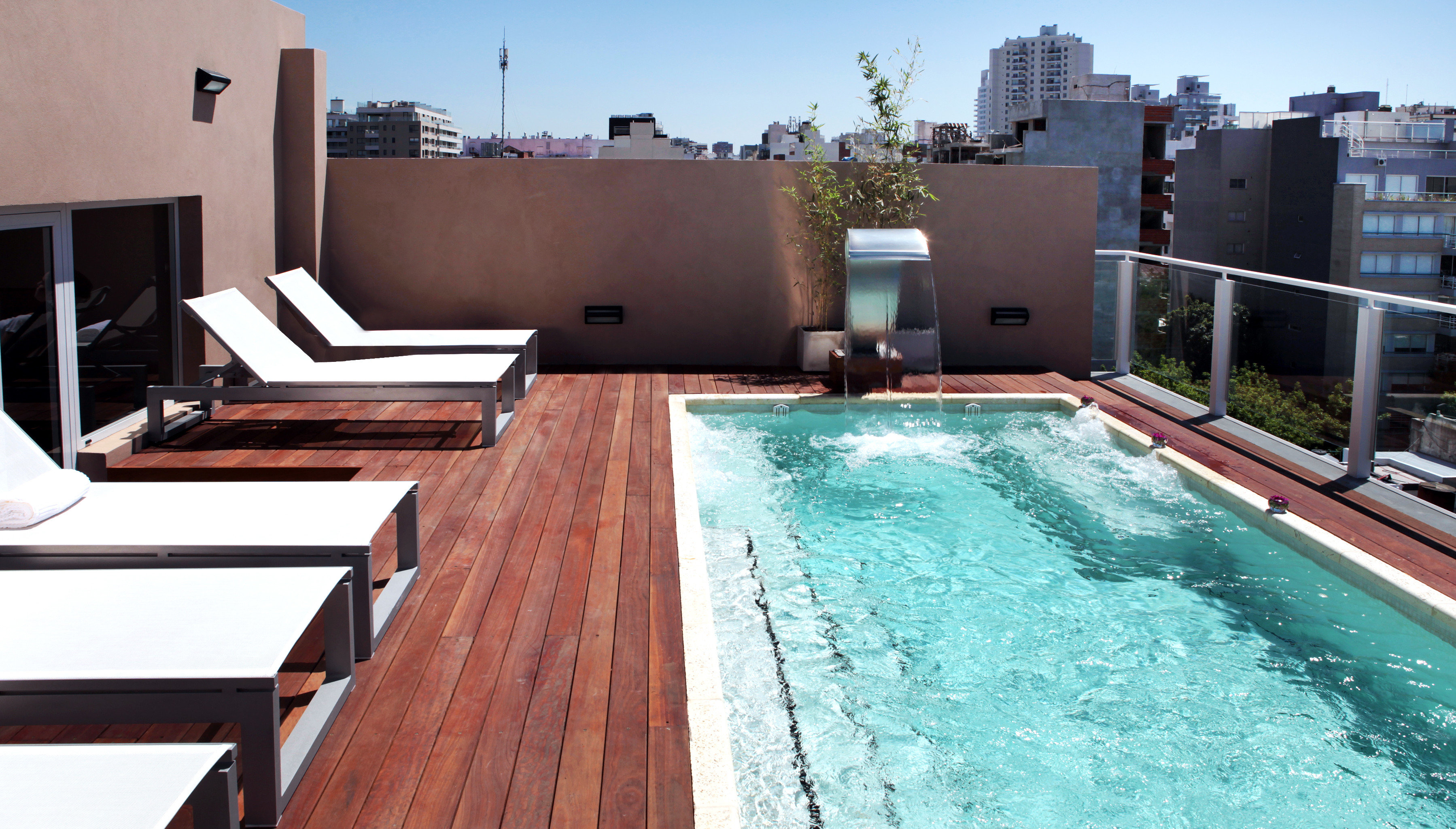 Boutique City Hip Pool Rooftop swimming pool property building house Villa backyard home condominium outdoor structure cottage Resort