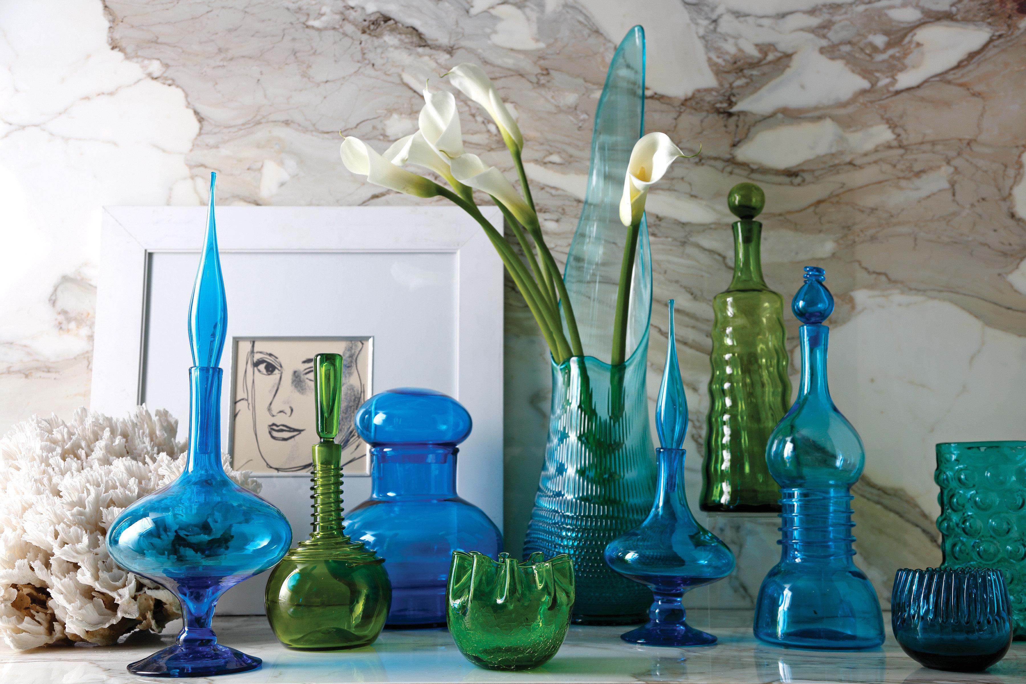 Boutique City Historic Lobby Lounge blue lighting glass bottle vase still life