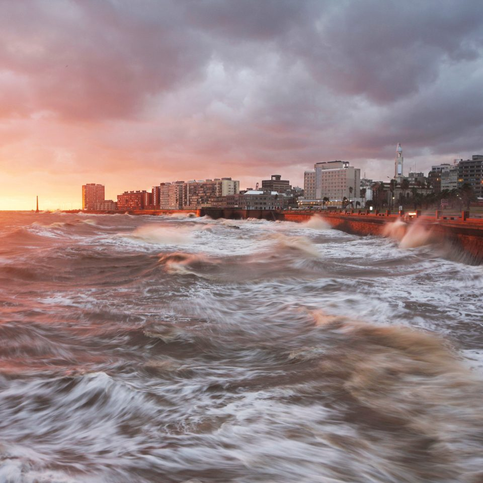 Boutique Scenic views Sunset Waterfront sky water shore Sea Coast atmospheric phenomenon wave River weather wind wave Ocean cloud morning evening dusk dawn waterway storm clouds