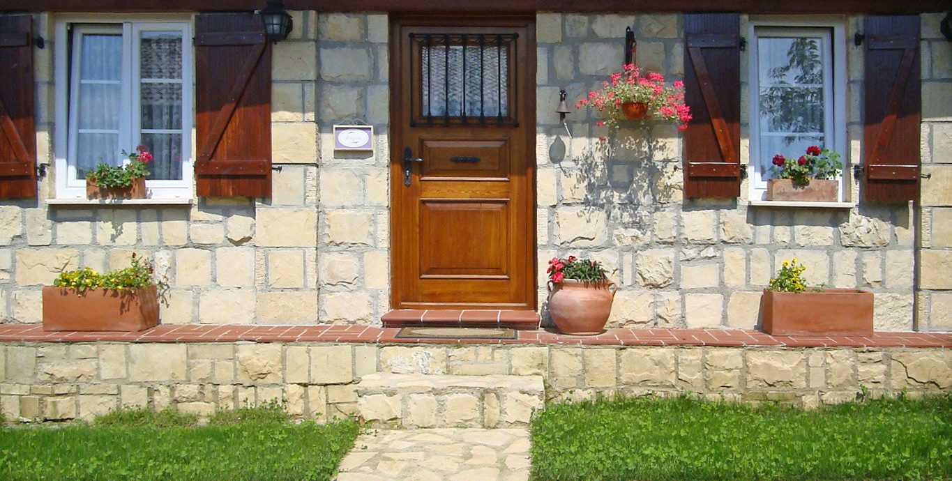 Boutique Country Exterior Rustic grass building property home yard brickwork Courtyard backyard cottage outdoor structure porch residential area hacienda landscaping brick Patio stone