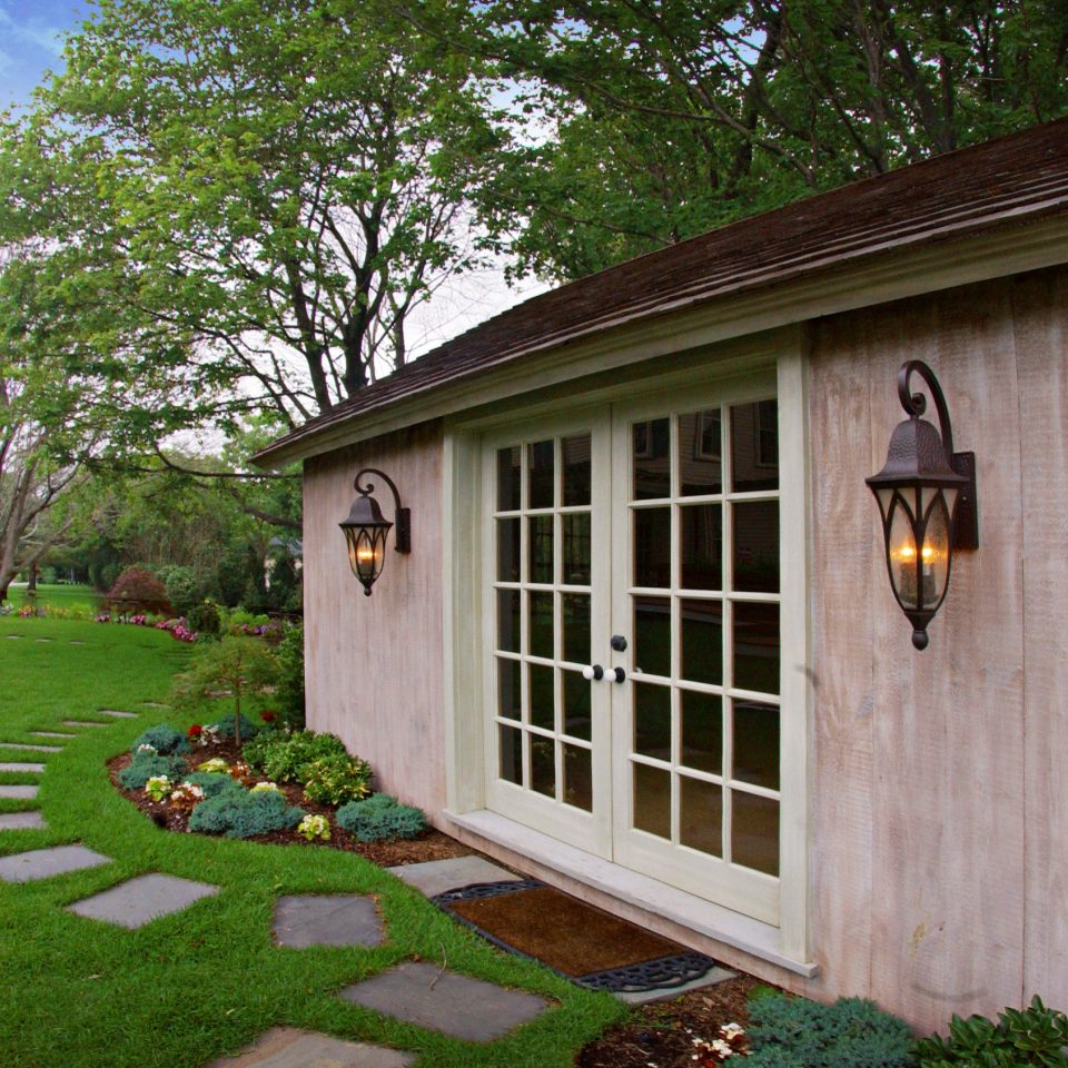 Boutique Country Eco Exterior Grounds Inn Outdoors grass building tree house property home wooden backyard yard cottage rural area shed outdoor structure old Garden siding lawn stone