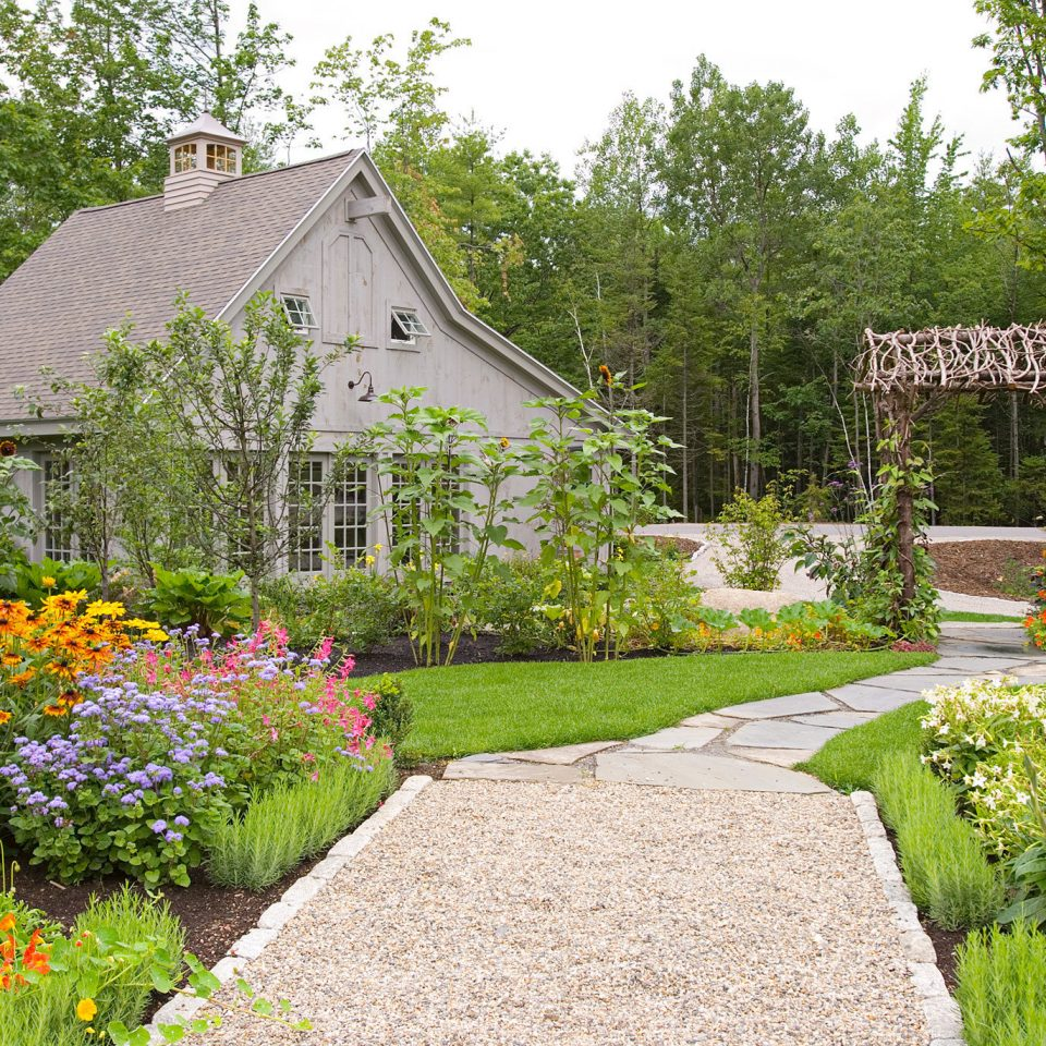 Boutique Country Exterior Outdoors Romantic tree grass flower Garden yard botany backyard lawn landscape architect cottage botanical garden garden designer outdoor structure shrub landscaping woodland house stone bushes surrounded