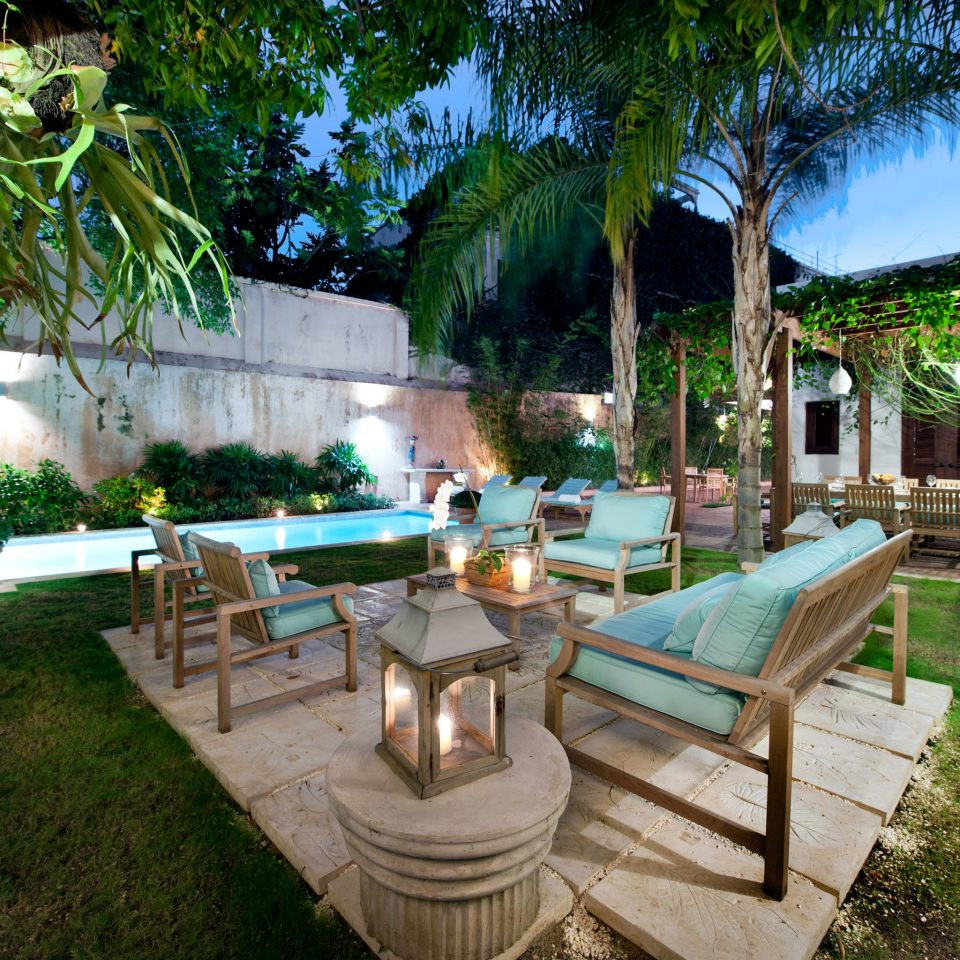 Boutique Cultural Deck Drink Eat Grounds Historic Lounge Patio Pool Terrace tree grass property Resort backyard park swimming pool Villa home hacienda Courtyard mansion Garden yard cottage stone