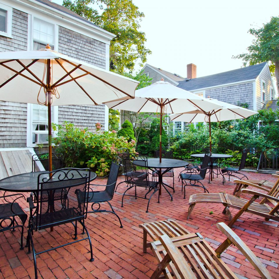 Boutique Deck Grounds Inn Patio Waterfront tree ground chair property backyard outdoor structure yard Garden park cottage Courtyard empty porch surrounded