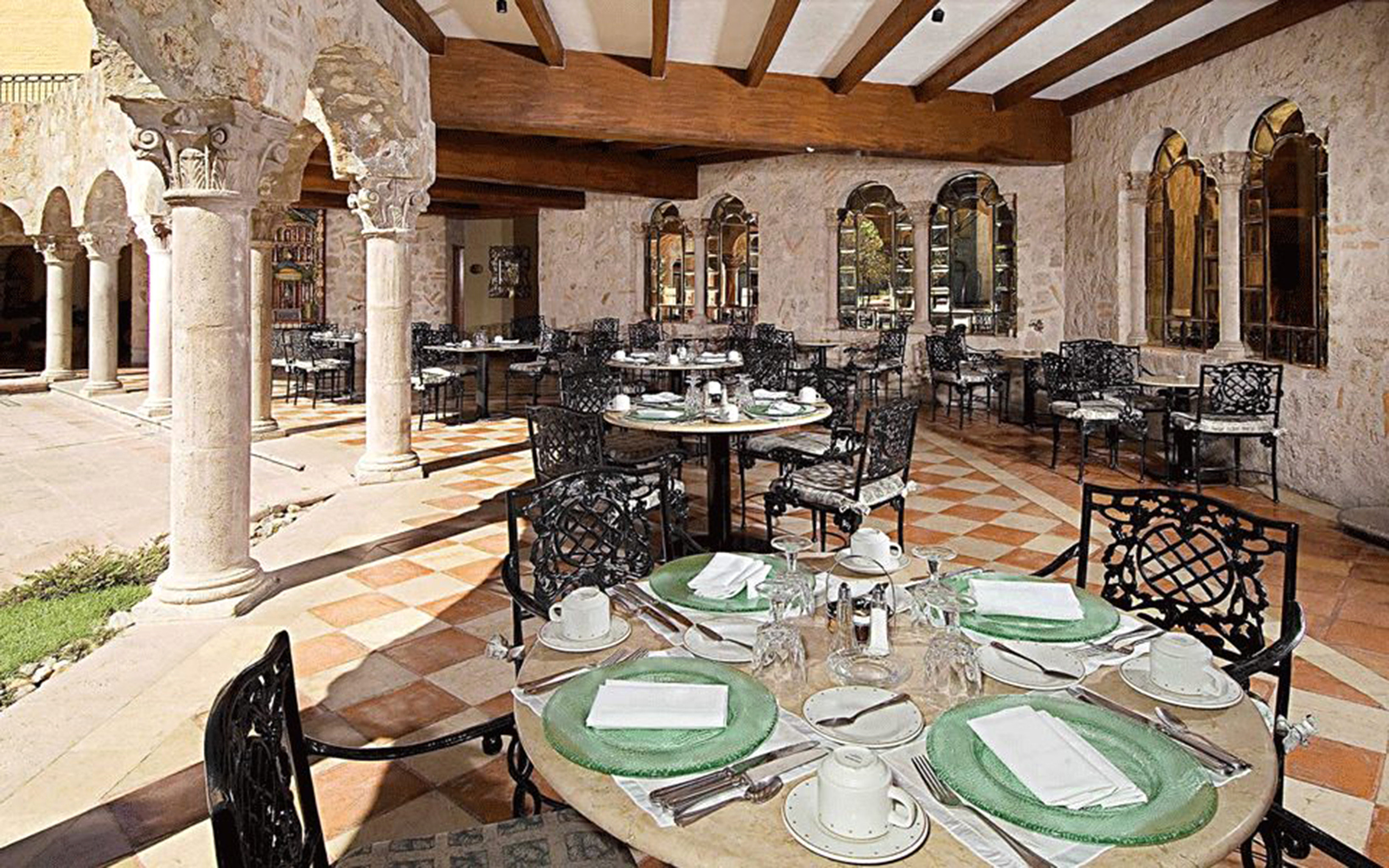 Boutique Courtyard Dining Drink Eat Family Historic Honeymoon Patio Romantic Town chair property building mansion home hacienda Villa restaurant palace cottage set dining table