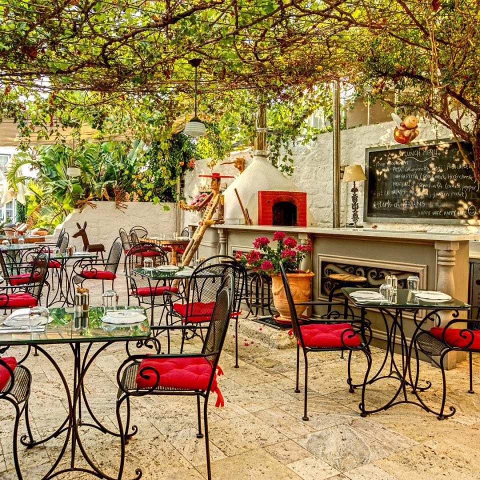 Boutique Dining Drink Eat Elegant Grounds Patio Rustic tree red restaurant backyard home outdoor structure yard Courtyard flower cottage