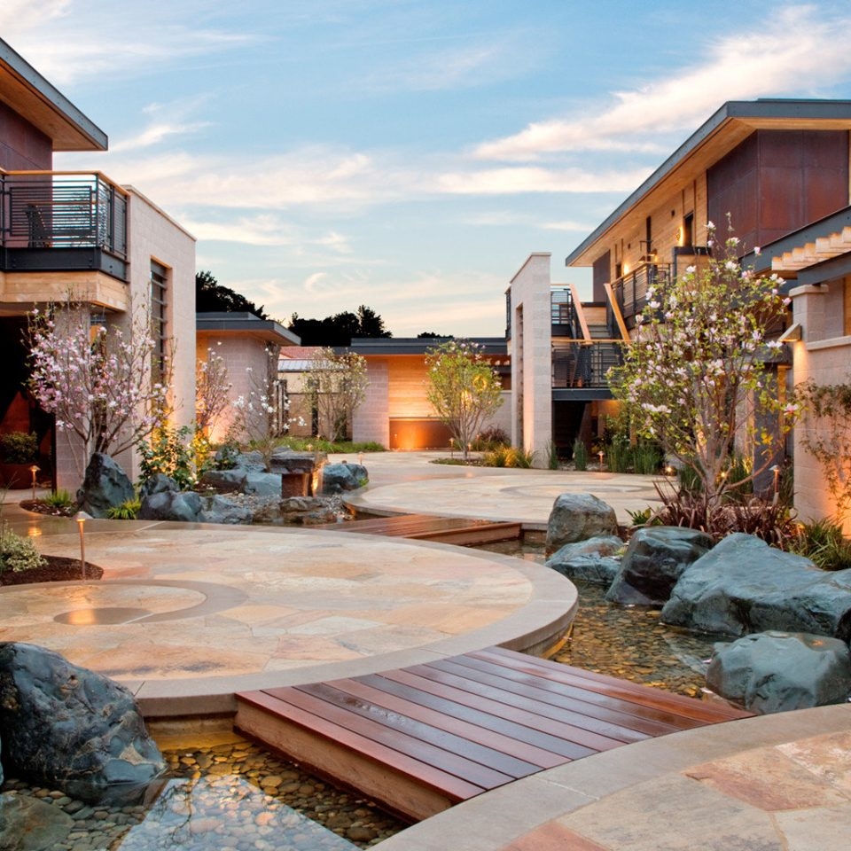 Boutique Eco Elegant Grounds Modern building sky property home house backyard Courtyard rock residential area yard mansion cottage Villa outdoor structure stone Resort landscaping swimming pool Patio paving