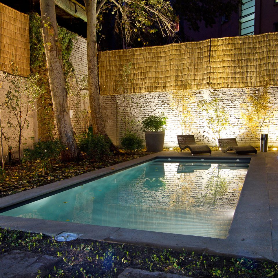 Boutique Outdoors Play Pool swimming pool backyard house night Courtyard reflecting pool landscape lighting water feature Garden yard mansion stone concrete cement